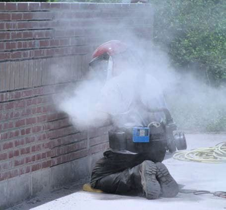 Bosch grinder grinding brick mortar joints - without using the Dust Director.