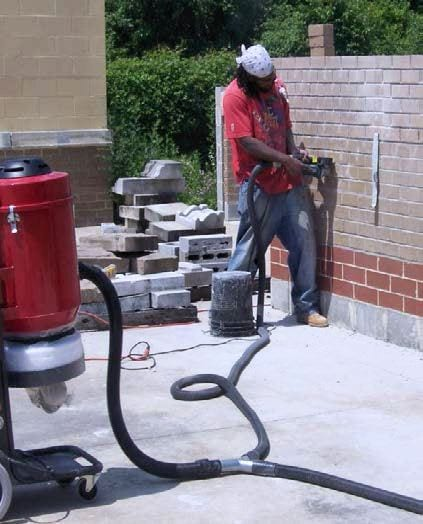 Grinding brick mortar joints using the Dust Director.