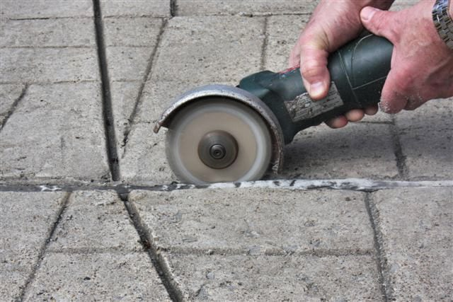 Slicing along the edge of an expansion joint.