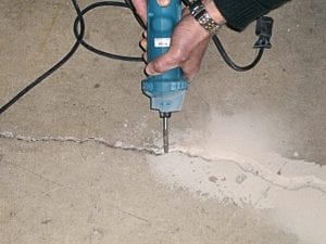 Tough, durable diamond bit grinds heavy aggregate . . . dust is kept on the grinding surface . . . it is not airborne.