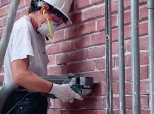 Grinding or cutting brick joints using the Dust Director.